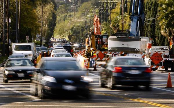 Traffic begins to back up on Coldwater Canyon Avenue at Ventura Boulevard in Studio City on a spring Friday morning. The important commuter route will be closed for major portions of the day, except Sundays, between Ventura Boulevard and Mulholland Drive for about a month while the DWP replaces an old water main.