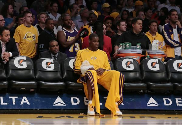 Lakers forward Antawn Jamison sits alone on the Lakers bench nursing an injured wrist.