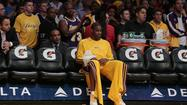 Antawn Jamison sprained his right wrist in the Lakers' 103-100 loss to the Washington Wizards on Friday.