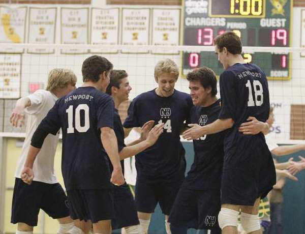 Newport Harbor's boys' volleyball team celebrates winning a point against Edison.