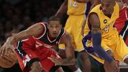 Kobe Bryant returned Friday night after missing almost three full games with a severely sprained ankle. The Lakers stormed ahead by 18 over the Washington Wizards only to see their lead slowly fade.