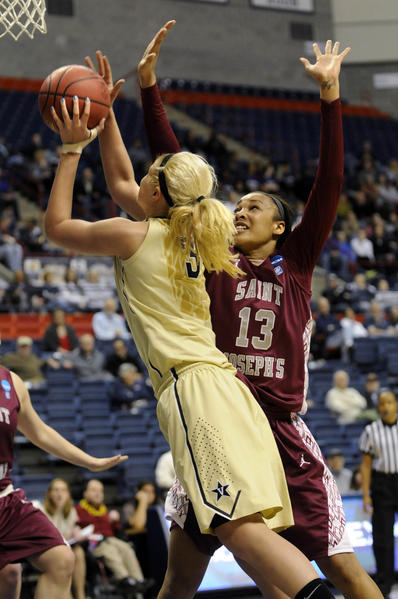 St. Joseph's forward Ashley Robinson (13) defends as Vanderbilt Commodores forward Heather Bowe (3) drives to the hoop in the first half in a first-round NCAA tournament game at Gampel Pavilion.