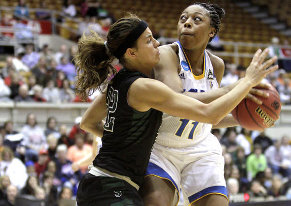 UCLA forward Atonye Nyingifa looks to score against Stetson guard Jama Sharp in the first half Saturday.