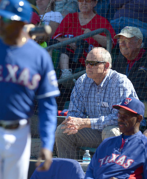 Rangers president Nolan Ryan (center) watches a game against the Giants during the sixth inning at Surprise Stadium.