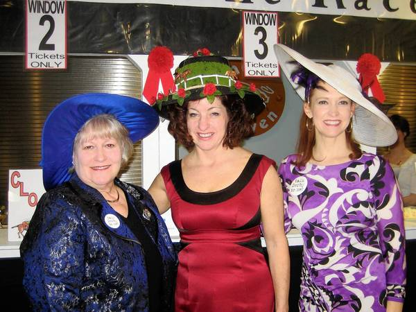 Decked out in fine Kentucky Derby-style attire at the A Night at the Races fundraiser for Child Care Information Services on March 9 are (from left) event chair and board member Martha Wells, event committee member Ellen Kingsley and Board Chair Jane Stone. Kingsley took first prize in the hat competition, while Stone came in third.