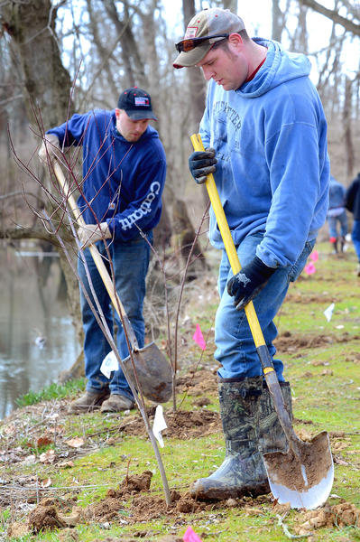 Volunteers John Bussard, left, of Clear Spring and Richie Derr, of Keedysville, planted Silky Dogwood trees on the banks of Beaver Creek Saturday afternoon.