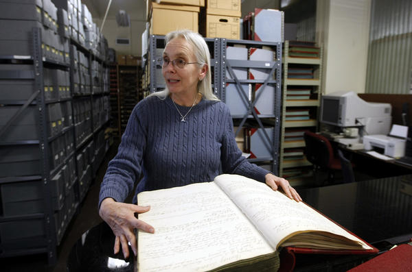 South Bend Tribune/GREG SWIERCZ Vicky Rydzynski, archivist/records manager with the St. Joseph County Archives & Records Center, talks about the move to a new building on Olive Street and the many digitization projects being done there.