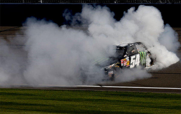 Kyle Busch does a burnout after winning the NASCAR Nationwide Series Royal Purple 300 at Auto Club Speedway.