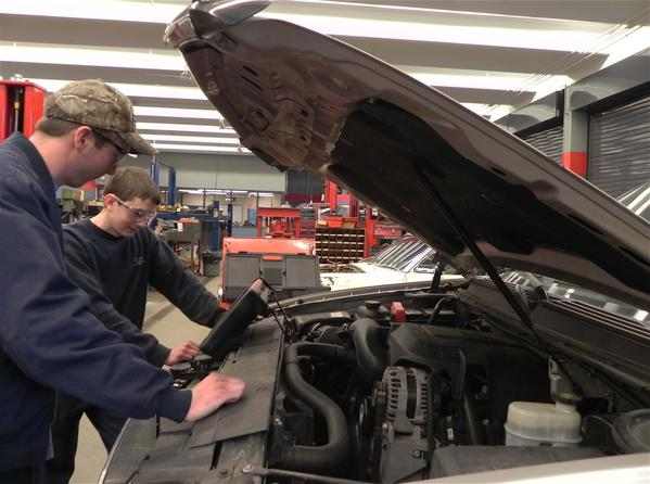 Students Brandon Clever, left, and Josh Long, both of Greencastle, Pa., will travel to New York City next month to compete in the 2013 National Automotive Technology Competition.