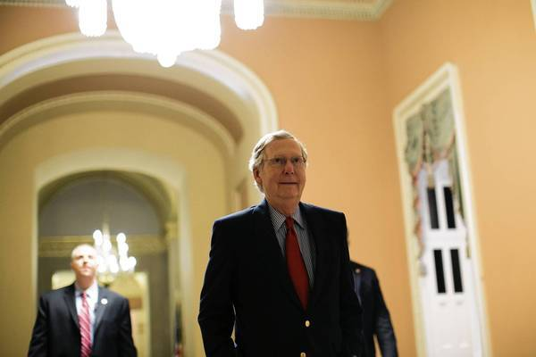 Senate Minority Leader Mitch McConnell (R-Ky.) heads from his office to the Senate chamber during a marathon voting session that produced a budget resolution but little agreement between Democrats and Republicans.