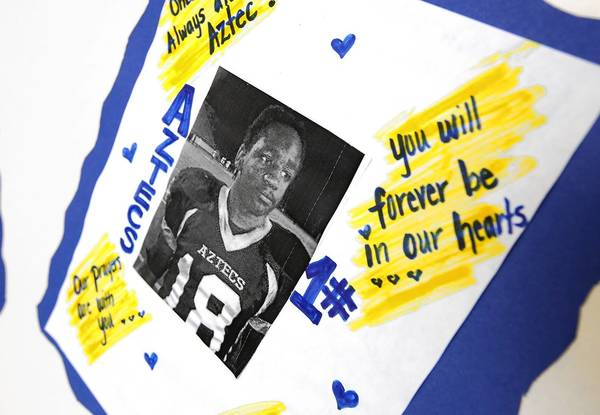 A photograph of Kendrec McDade accompanies messages on display during his funeral service at Metropolitan Baptist Church in Altadena in April 2012.