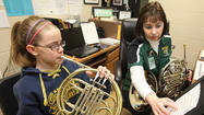 Can a student learn a musical instrument as early as the first or second grade?