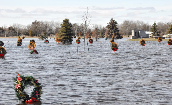 Much of Sunset Memorial Gardens was under a few inches of water because of flooding throughout the region in May 2010. American News File Photo by Anita Meyer