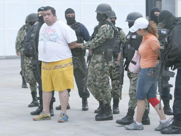 Mexican soldiers arrest former Police Chief Jose Osiris Cruz Cabrera, left, and Cristian Jannet Perez Torres in Veracruz in September. They were among dozens held in connection with the disappearance of a customs official.