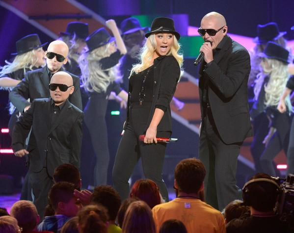 Singer Christina Aguilera and rapper Pitbull perform onstage.