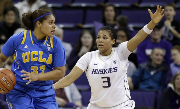 UCLA's Alyssia Brewer drives against Washington's Talia Walton during a Pac-12 game this season.