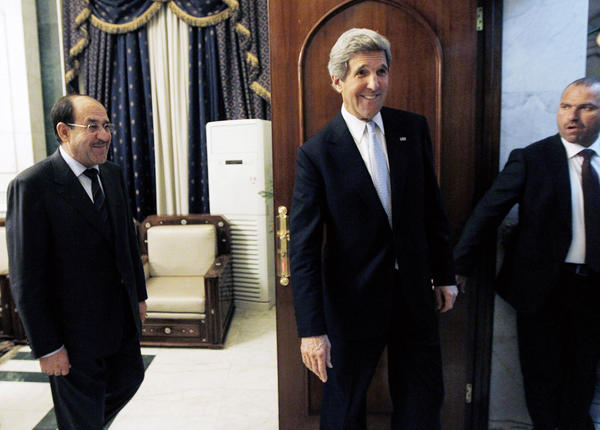 U.S. Secretary of State John Kerry after meeting with Iraqi Prime Minister Nouri Maliki, left, in Baghdad on Sunday.