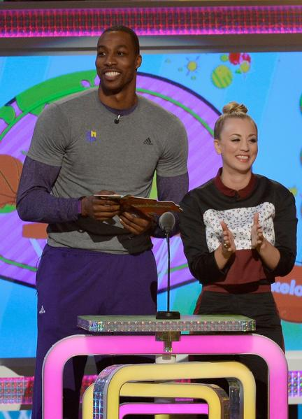 "Los Angeles Lakers player Dwight Howard and ""The Big Bang Theory"" actress Kaley Cuoco present an award onstage."