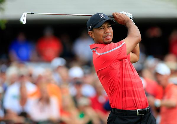 Tiger Woods hits his tee shot at No. 1 to open the final round of the Arnold Palmer Invitational at Bay Hill on Sunday.