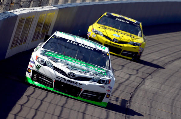 Kyle Busch leads Matt Kenseth during the early stages of the NASCAR Sprint Cup Auto Club 400 race in Fontana on Sunday.