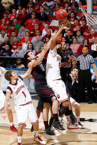 Christian Watford #2 of the Indiana Hoosiers goes for a rebound against T.J. DiLeo #11 and Rahlir Hollis-Jefferson #32 of the Temple Owls during the third round of the 2013 NCAA Men's Basketball Tournament at UD Arena on March 24, 2013 in Dayton, Ohio.