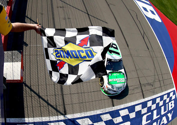 Kyle Busch drives his No. 18 Interstate Batteries Toyota across the finish line to win the NASCAR Sprint Cup Auto Club 500 on Sunday in Fontana.