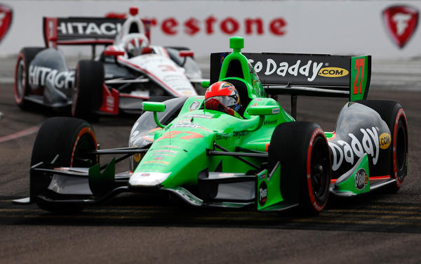 (R) James Hinchcliffe of Canada, driver of the #27 GoDaddy.com Andretti Autosport Dallara Chevrolet leads (L) Helio Castroneves of Brazil, driver of the #3 Hitachi Team Penske Dallara Chevrolet in the IZOD IndyCar Series Honda Grand Prix of St Petersburg on March 24, 2013 in St Petersburg, Florida.