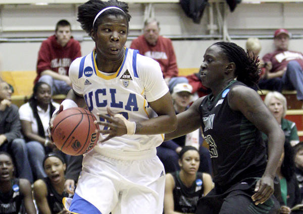 UCLa guard Markel Walker drives the baseline against Stetson's Shanasa Sanders in the first half of an NCAA tournament first-round game Saturday.