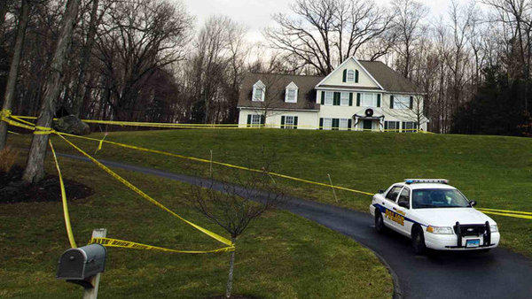 A police cruiser sits parked in the driveway outside Nancy Lanza's Newtown home on Dec. 18.
