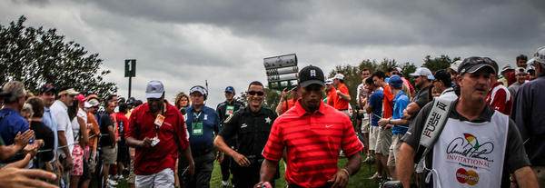 Tiger Woods walks to the 2nd hole during the final round of play in the Arnold Palmer Invitational PGA golf tournament in Orlando, Fla. on Sunday, March 24, 2013.