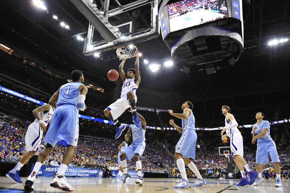 Kansas' Kevin Young drives in for a dunk against North Carolina in the first half.