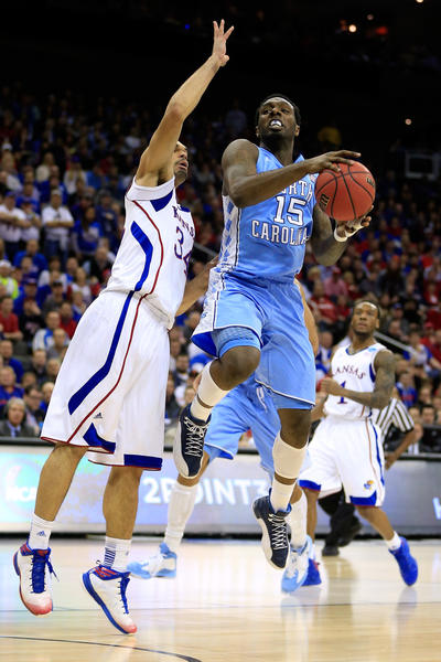 P.J. Hairston #15 of the North Carolina Tar Heels drives for a shot attempt against Travis Releford #24 of the Kansas Jayhawks during the third round of the 2013 NCAA Men's Basketball Tournament at Sprint Center on March 24, 2013 in Kansas City, Missouri.