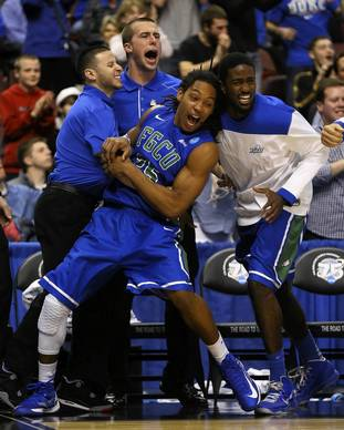 Florida Gulf Coast's Sherwood Brown celebrates with teammates on the bench in the second half while taking on San Diego State.
