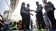 Foot Locker employees wait