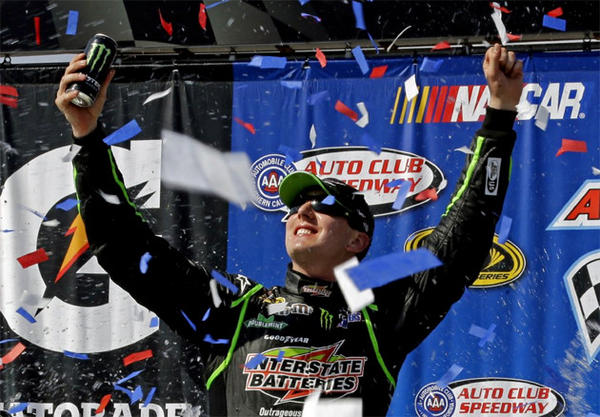 Kyle Busch celebrates his win at the Auto Club 400 race in Fontana.
