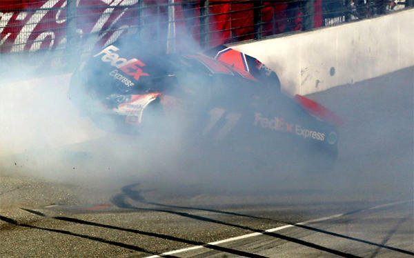 Denny Hamlin hits the wall after colliding with Joey Logano (not pictured) on the final lap.