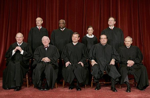"A group photo of the Supreme Court justices in 2006: seated, from left, are Anthony M. Kennedy, John Paul Stevens, John G. Roberts, Antonin Scalia  and <a href=""http://www.latimes.com/news/nationworld/washingtondc/la-na-souter1-2009may01,0,7280499.story"">David H. Souter</a>; standing,  Stephen G. Breyer, Clarence Thomas, Ruth Bader Ginsburg and Samuel Alito."