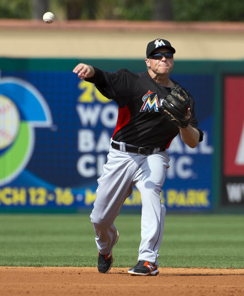 Feb 28, 2013; St. Louis, MO, USA; Miami Marlins shortstop Chris Valaika (13) throws out a St. Louis Cardinals base runner at Roger Dean Stadium. The Cardinals defeated the Marlins 8-2. Mandatory Credit: Scott Rovak-USA TODAY Sports ORG XMIT: USATSI-127332