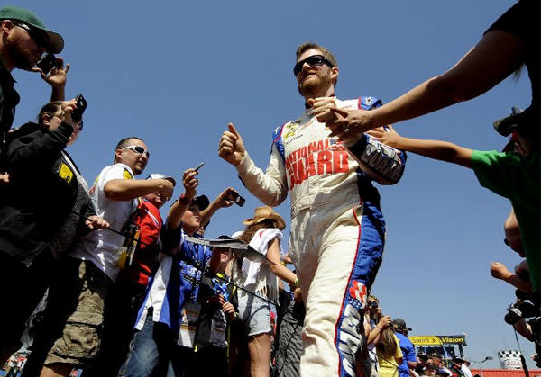 Dale Earnhardt Jr. greets fans before the start of the Auto Club 400 in Fontana.