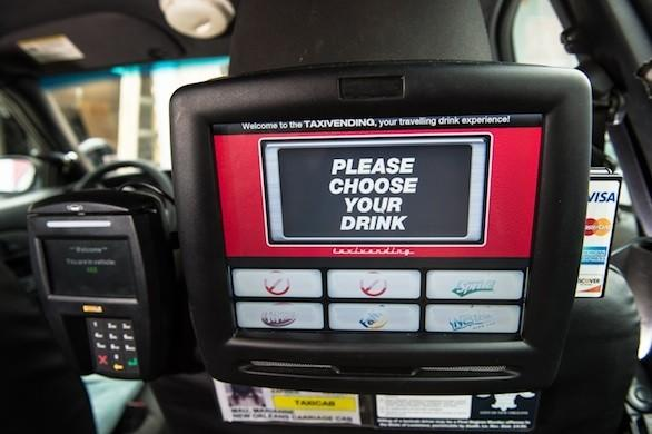 The touchscreen soft-drink dispenser inside a New Orleans cab.