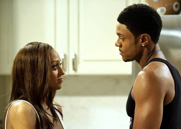 "Tia Mowry (Melanie) and Pooch Hall (Derwin) on BET's ""The Game"" in October 2010 in Atlanta."
