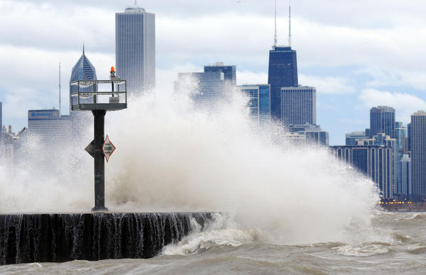 Waves crash at the lakefront near the 39th Street beach early Monday morning. A snowstorm that buried central and southern Illinois only skirted Chicago as it headed east -- and with it maybe the last of an unusual winter that seemed would never end.