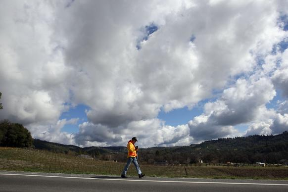 Ric Ryan strolls along California 4 near Murphys, in Calaveras County. Known as the the Walking Man of Murphys, Ryan, a 67-year-old Vietnam veteran