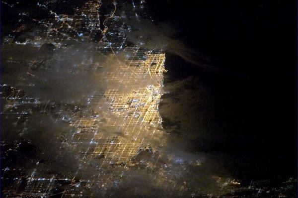 A photo of Chicago posted from the International Space Station Saturday.
