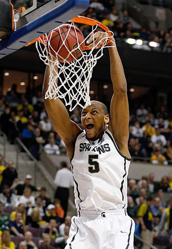Michigan State's Adreian Payne dunks against the Memphis Tigers during second-round play of the NCAA Men's Basketball Tourney on March 23.