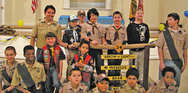 Cub Scouts from Pack 34 held the annual Blue and Gold Banquet and Crossover Ceremony March 9. Three eligible Webelos Scouts crossed over to Boy Scout Troop 412. Back row, from left, Noel Macias (Webelos leader) Drew Hoffman, Michael Hoffman, Antonio Roldan, Mitchell Gearhart, Jeff Koogle and Aaron Haden (Troop 412). Middle row, Ryan Maguire (Troop 412) , Kole Faokunla (Troop 412), Dane Arasmith and Javon Boyer. Front row, Sean Maguire, Joshua Macias, Brendan Heisler and Devonte Johnson (Troop 412). Sean Maguire, Joshua Macias and Heisler all crossed over to Troop 412.