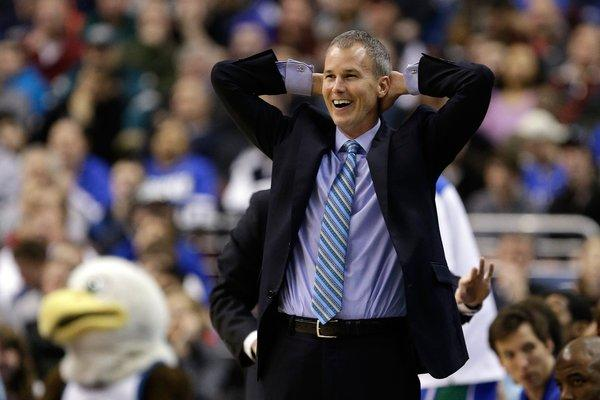 Florida Gulf Coast University Coach Andy Enfield smiles during a game with San Diego State University Aztecs in the NCAA tournament.
