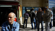 ATHENS -- Defending a last-resort deal with international lenders, bleary-eyed officials on Cyprus said Monday that they had managed to avert a devastating default for the tiny Mediterranean nation and kept it from being forced out of Europe's single-currency family.