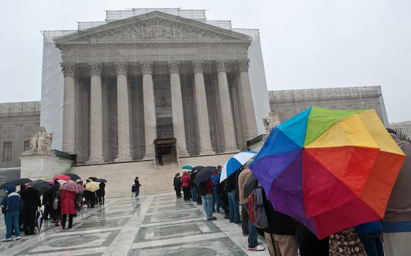 People line up to enter the Supreme Court in Washington. The justices will hear arguments on California's Proposition 8 ban on same-sex marriage on Tuesday and on the federal Defense of Marriage Act, which defines marriage as between one man and one woman, on Wednesday.
