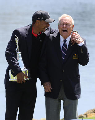 Tiger Woods and Arnold Palmer share a laugh and hug after Woods won his eigth Arnold Palmer Invitational in Orlando, Fla. Monday, March 25, 2013.  (Gary W. Green/Orlando Sentinel)